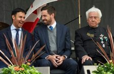 Mr. Levente Magyar (middle) with a member of the Vitézi Rend at the podium of the HungaroFest in Toronto.