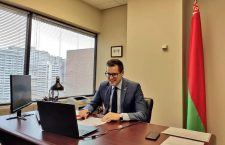 Evgeny Russak smiles in his office in downtown Ottawa, before the shuttering of the Embassy of Belarus. Photo: Facebook.